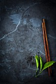 Chopsticks and lemon leaves