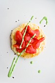 A mini tomato pizza with goat's cheese coriander pesto