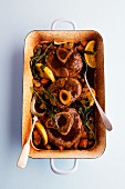 Braised veal knuckle with oranges and sage