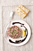 Duck breast tartare with sesame seeds and chives