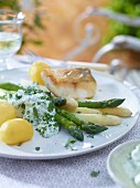 Zander with asparagus with a herb and yoghurt sauce