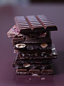 A stack of different bars of chocolate