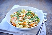 Shell pasta with salmon and dill