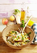 Colourful radish salad with apples and walnuts