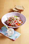 Sausage salad with pepper and radishes