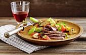 Warm steak salad with potatoes and tomatoes