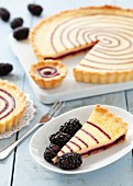 Blackberry and vanilla pudding tart, sliced