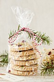 White chocolate biscuits with pistachios and cranberries in a cellophane bag as a gift