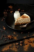 A slice of cheesecake with star anise, cinnamon and cloves