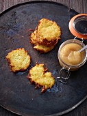 Potato fritters with apple sauce in a flip-top jar