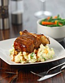 Beef ribs on a bed of mashed potatoes