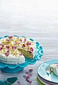 Lemon cake with rose petals, sliced