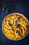 Pumpkin quiche with bacon, Parmesan and oregano