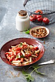 Vegetarian penne pasta with goji berries, tomatoes and mince