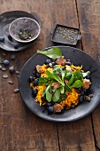 Vegan salad with lamb's lettuce, pumpkin, blueberries, pumpkin seeds and croutons
