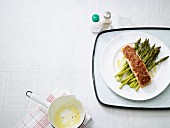 Salmon with a spicy sesame seed crust on a bed of green asparagus (low carb)
