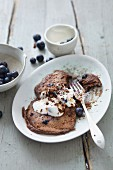 Spelt and carob pancakes with blueberries and coconut yoghurt