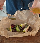A beetroot parcel with pears being prepared for grilling