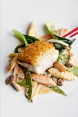 Monk fish with a ginger crust on a bed of stir-fried vegetables with coconut milk