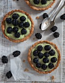 Vegan blackberry tartlets with avocado and soya cream