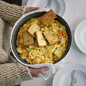 Vegetarian, oven-baked risotto with Hokkaido pumpkin and smoked tofu