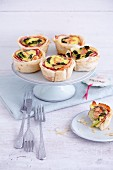 Filo tartlets with salmon, broccoli and apples