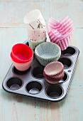 Baking cases and a muffin tin