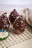 Strawberry meringue cupcakes with dark chocolate glaze