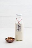 Almond milk in a glass bottle with a label