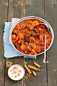 Braised aubergines with a pepper and tomato sauce, raisins, almonds and cinnamon
