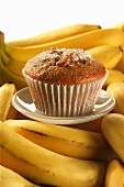 A banana muffin on ripe bananas