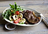 Beef tagliata on a mushroom salad