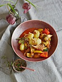 Ratatouille with artichokes, roast potatoes and almonds