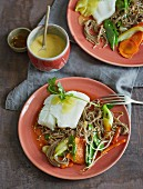 Steamed cod with soba noodles, vegetables and sesame seeds