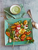 Fried potato salad with water cress and radishes