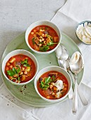 Chickpeas stew with aubergines, tomatoes and sumach yoghurt