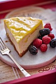 A slice of cheesecake with red berries