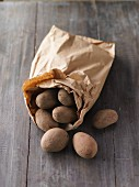 A paper bag of potatoes from a market