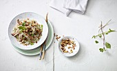 Stir-fried glass noodles with duck breast, peanuts and coriander