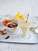 A mango shake with walnuts, chia seeds and honey