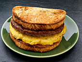 A toasted sandwich with sausage and egg for breakfast (USA)