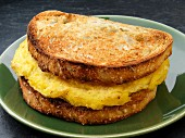 A toasted scrambled egg breakfast sandwich (USA)