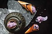 Blueberry ice cream in homemade cones