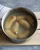 Sausages being boiled