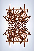 A digital composition of mirrored images of an arrangement of pretzel sticks
