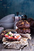Chocolate homemade bagels with cream cheese and strawberries