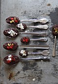Spoons of chocolate, goaded berries and nuts