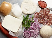 An arrangement of various pizza ingredients