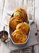 Raisin buns with apricot glaze