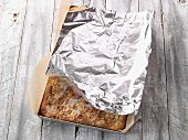 Butter cake covered with aluminium foil